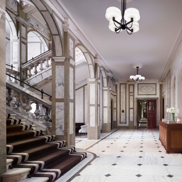 Hotel corridor with grand staircase and archways