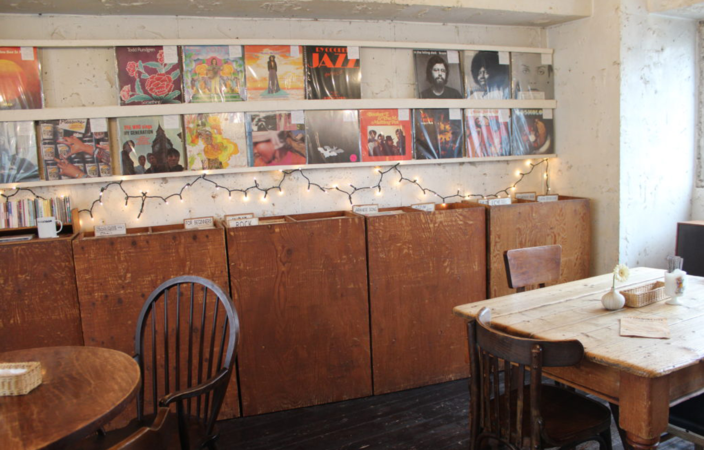 City Country City record store and cafe vinyl on display and tables and chairs Tokyo