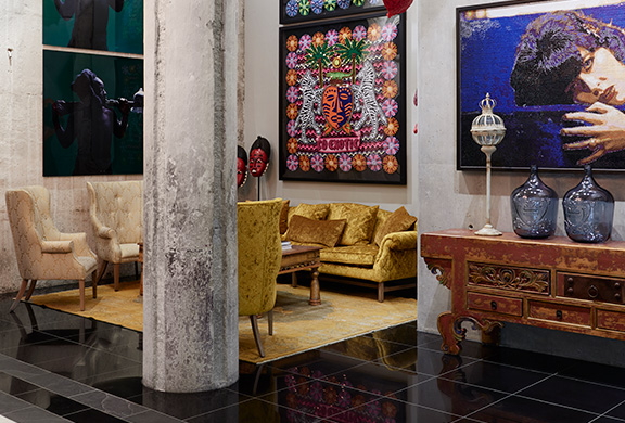 Hotel lobby bold interiors stone pillar contemporary African art vibrant colours
