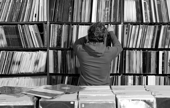 Man searching through LP records in record shop