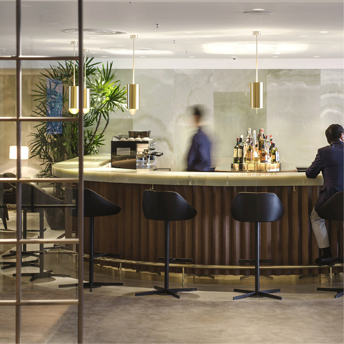 First class airport lounge bar with bar staff and guest