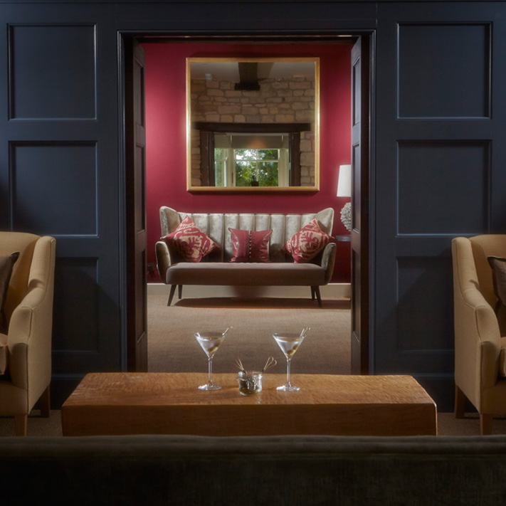 View through panelled double doors into lobby lounge