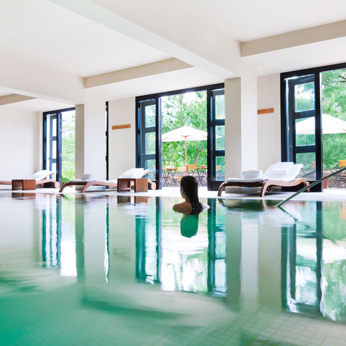 Woman in indoor swimming pool